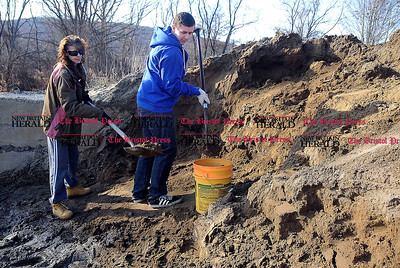 1/1/2014 Mike Orazzi | Staff Michelle Smith and Tyler Oakes fill buckets with sand at the city lot on Vincent P Kelly Road in Bristol in anticipation of a snow fall on Wednesday night.