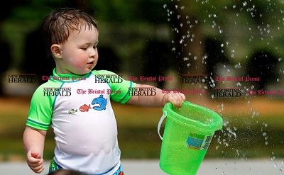 Kevin Bartram | Staff Jack McCarthy, 21 months old, plays at the new splash pad at Paderewski Park in Plainville on Tuesday. The addition to the park opened on Monday.