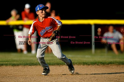 Kevin Bartram | Staff McCabe-Waters second baseman Nate Duhaime reacts to a ground ball during a game between McCabe-Waters from Bristol and Southington South on Tuesday in Southington.