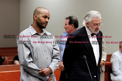 Kevin Bartram | Staff Larry Williams appears with his public defender in a New Britain courtroom on Tuesday where he was charged in connection with an assault that happened at Central Park on Monday.