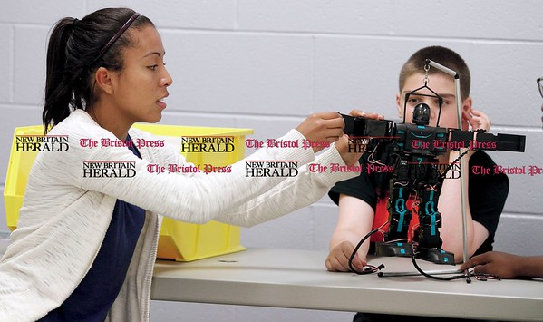 Kevin Bartram | Staff Aryana Vazquez talks about her robot as New Britain High School students demonstrate the robots they built as part of the Young Engineers program sponsored by the Boys and Girls Club and CCSU. The students built two robots over a four-day period.