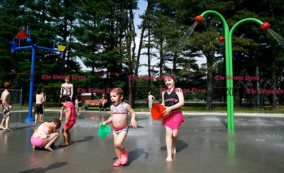 Kevin Bartram | Staff Children play at the new splash pad at Paderewski Park in Plainville on Tuesday. The addition to the park opened on Monday.