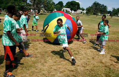 Kevin Bartram | Staff Mekhi Edwdards, 13, runs from a large ball during a game at the Leaders in Training summer camp at A.W. Stanley Park in New Britain on Tuesday.