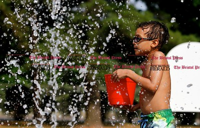 Kevin Bartram | Staff Tanner Nilson, 6, plays at the new splash pad at Paderewski Park in Plainville on Tuesday. The addition to the park opened on Monday.