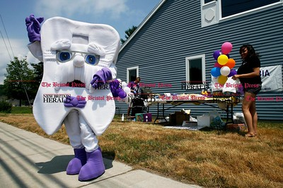 Kevin Bartram | Staff Professor Tooth greets people passing by the new Columbia Dental office at 169 Middle Street in Bristol on Wednesday.