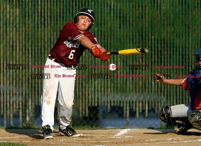 Kevin Bartram | Staff South's Jake Neuman reaches for an outside pitch during a game between McCabe-Waters from Bristol and Southington South on Tuesday in Southington.