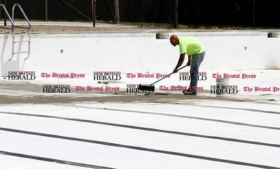 Kevin Bartram   Staff New Britain city worker Domenick Mutone repairs the pool at A.W. Stanley Park on Monday. The pool opens for the season on Saturday, June 21 at 1 p.m.