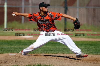 Kevin Bartram | Staff Goodwin's Agustin Cruz pitches during a First round of Class M State Tournament game between Goodwin Tech and Vinal Tech on Monday at Goodwin Tech in New Britain.