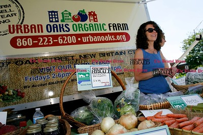 Kevin Bartram | Staff Peggy Hall greets customers as the Urban Oaks Organic Farm mobile farmer's market truck makes it's debut at the Community Health Center in New Britain on Monday. The schedule from June through August will be Mondays from 1 to 3 p.m. at the Community Health Center on Lafayette Street, Tuesdays from 2:30 to 4:30 p.m. at the Jefferson School on Horse Plain Road, Wednesdays from 12:30 to 2:30 p.m. at the senior center on Pearl Street and Thursdays from 2:30 to 4:30 p.m. at the Smith School on Rutherford Street.