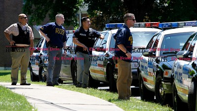 Kevin Bartram   Staff New Britain police watch a house on Vincent Avenue near Roxbury Road on Monday after Emergency Medical Services workers were dispatched to the house then refused entry by the occupant.