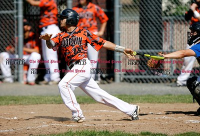 Kevin Bartram   Staff Goodwin's Jorge Rivera hits during a First round of Class M State Tournament game between Goodwin Tech and Vinal Tech on Monday at Goodwin Tech in New Britain.