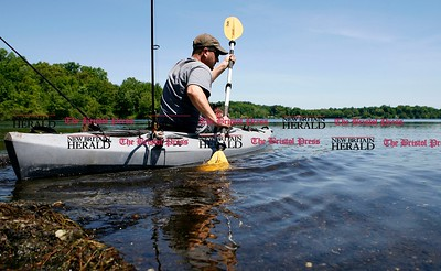 Kevin Bartram   Staff Dan Emerson of Newington spends a day off fishing at Batterson Park Pond in New Britain on Monday.