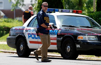 Kevin Bartram | Staff New Britain police watch a house on Vincent Avenue near Roxbury Road on Monday after Emergency Medical Services workers were dispatched to the house then refused entry by the occupant.