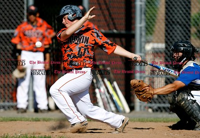 Kevin Bartram   Staff Goodwin's Benjamin Hampson hits during a First round of Class M State Tournament game between Goodwin Tech and Vinal Tech on Monday at Goodwin Tech in New Britain.
