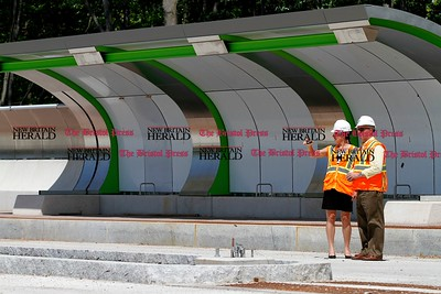 Kevin Bartram | Staff Nancy Lyon Stadler, left, and Tom Strand stand in the Cedar Street station as CTFastrak officials tour sections of the busway in New Britain and Newington on Monday to check the progress of construction.