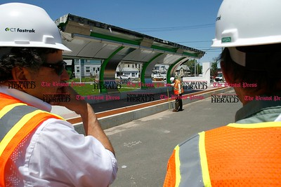Kevin Bartram | Staff CTFastrak officials examine the East Main Street station as they tour sections of the busway in New Britain and Newington on Monday to check the progress of construction.