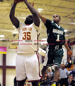 3/1/2014 Mike Orazzi | Staff New Britain's Craven Johnson (35) and Weaver's Jaecee Martin (1) during the CCC Boys Basketball Tournament at Bulkeley High School Saturday night in Hartford.