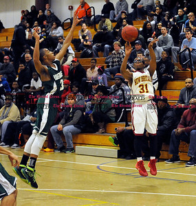 3/1/2014 Mike Orazzi | Staff New Britain's Ubaydullaah Chislum (31) during the CCC Boys Basketball Tournament at Bulkeley High School Saturday night in Hartford.