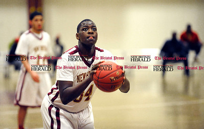 3/1/2014 Mike Orazzi | Staff New Britain's Annuel Saint Juste (34) during the CCC Boys Basketball Tournament at Bulkeley High School Saturday night in Hartford.