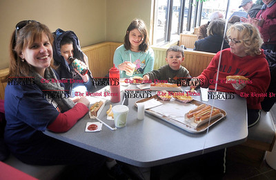 3/1/2014 Mike Orazzi | Staff Theresa Little, Ian Little, Ellie Little, Ryan Little and Ronie Mason while eating at Frankies on Route 6 in Bristol Saturday. The local hot dog restaurant is celebrating 30 years under the same ownership.