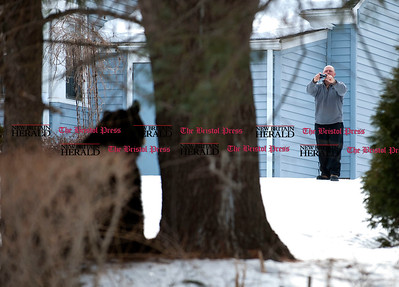 3/4/2014 Mike Orazzi | Staff Pete Wojtusik watches a black bear in the Glendale Drive area of Bristol on Tuesday afternoon.