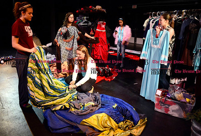 5/1/2014 Mike Orazzi | Staff Bristol Central High School students Destiny Whitten, Sydney Buonfiglio, Libby Blauvelt, Taneysha Burgos and Nilka Diaz with some of the costumes the school will be selling along with other props this Saturday.