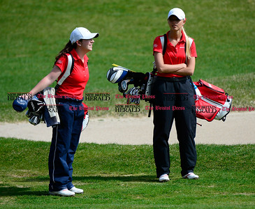 5/1/2014 Mike Orazzi | StaffBerlin High School's Ashley D'Attilio and Julia Kemmling during Thursday's match with Conard High School at the Timberlin Golf Club.