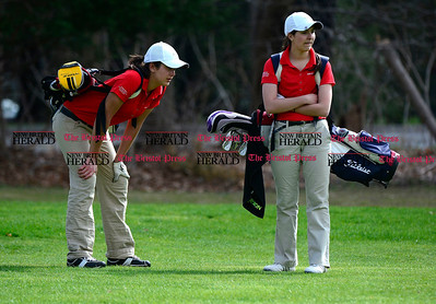 5/1/2014 Mike Orazzi | StaffBerlin High School's Megan Pskowksi and Alex Perrone during Thursday's match with Conard High School at the Timberlin Golf Club.