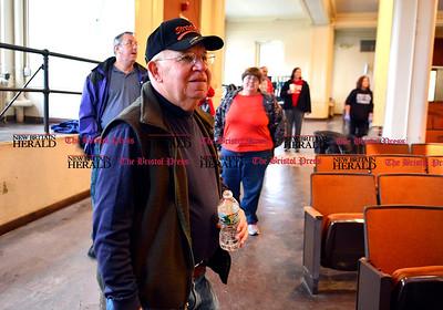 11/1/2014 Mike Orazzi | Staff Frank Stawski helps lead cleanup of former Memorial Boulevard School.