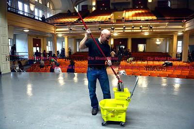 11/1/2014 Mike Orazzi | Staff Volunteer Jesse Gallagher helps clean up the former Memorial Boulevard School in Bristol on Saturday.