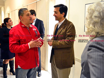 11/1/2014 Mike Orazzi | Staff Gil Martinez talks with Luis Fortuno, former governor of Puerto Rico during his visit to New Britain city hall on Saturday morning.