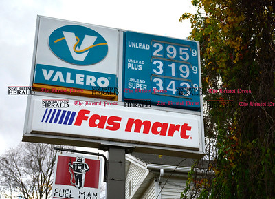 10/30/2014 Mike Orazzi | Staff Jazmine Torres while filling up with gas for $2.95 per gallon at the Valero gas station on West Street at Chestnut Street in Bristol on Thursday afternoon.