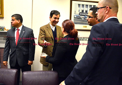 11/1/2014 Mike Orazzi | Staff Luis Fortuno, former governor of Puerto Rico with mayor Erin Stewart during his visit to New Britain city hall on Saturday morning.