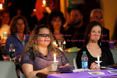 Kevin Bartram | Staff Valerie Montgomery, left, and Jenna Hussman hold candles during a candlelight vigil at the Prudence Crandall Center in New Britain on Wednesday.