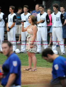 6/24/2010 Mike Orazzi | Staff Mary Denehy sings the national anthem at the start of the Bristol Collegiate baseball game vs Lowell on Thursday night.