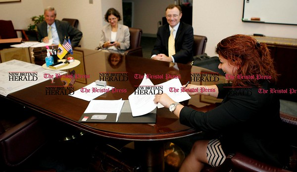 Kevin Bartram | Staff Mayor Erin Stewart signs a contract with Costco on Tuesday at City Hall. A groundbreaking ceremony is scheduled for 10 a.m. Wednesday at Stanley Golf Course.