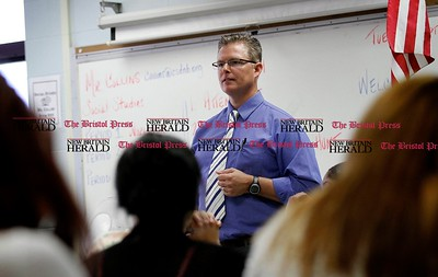 Kevin Bartram | Staff Social studies teacher Steve Collins talks to students on Tuesday during the first day of school at the New Britain High School Satellite Academy located inside the Roosevelt Middle School building.
