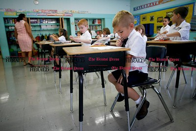 Kevin Bartram | Staff First grader Jakub Sek sits in class during the first day of school at Saint John Paul II School in New Britain on Tuesday.
