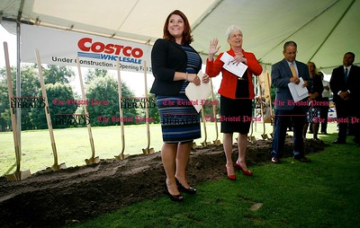 Kevin Bartram | Staff New Britain Mayor Erin Stewart, left, and Lt. Gov. Nancy Wyman speak during a groundbreaking ceremony on the Stanley Golf Course for the New Britain Costco store. Some holes on the course will be relocated to make room for the retailer which expects to open next year.