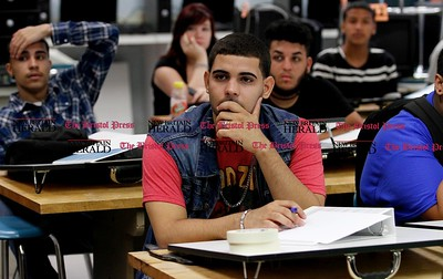 Kevin Bartram | Staff Senior Edwin Arroyo, 18, sits in class on Tuesday during the first day of school at the New Britain High School Satellite Academy located inside the Roosevelt Middle School building.