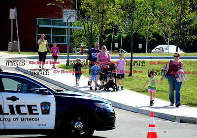 9/3/2014 Mike Orazzi | Staff A Bristol Police officer directs parents outside the Greene-Hills School after bomb threat was found inside one of the girls' bathrooms on Wednesday afternoon.