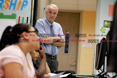 Kevin Bartram | Staff Principal Michael Foran checks on students on Tuesday during the first day of school at the New Britain High School Satellite Academy located inside the Roosevelt Middle School building.
