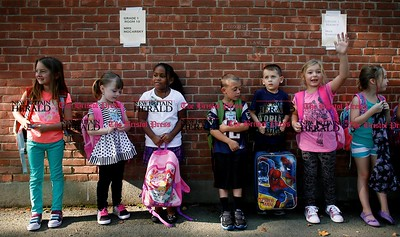 Kevin Bartram | Staff First graders wait for class to start during the first day of school at Frank T. Wheeler Elementary School in Plainville on Tuesday.