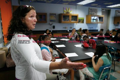 Kevin Bartram | Staff Board of Education president Sharon Beloin-Saavedra visits a classroom on Tuesday during the first day of school at the New Britain High School Satellite Academy located inside the Roosevelt Middle School building.