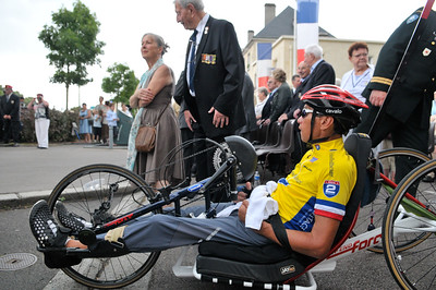Participants attend a ceremony in Caen, France during the 2014 Normandy Challenge.  As a 501(c)(3) organization, R2R helps injured active duty service members and veterans improve their health and wellness through individual and group cycling.