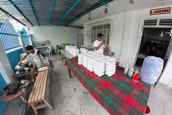 Food for children and villagers after the memorial prayer for Tatay