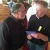 LCC President Tim Hetzner presenting gift cards and money to Rev Terry Makelin of Pilger