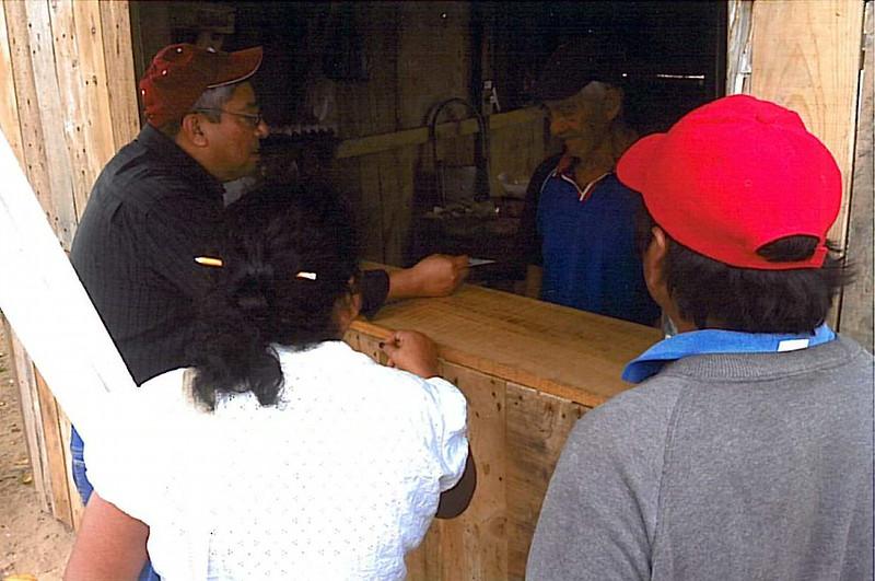Pastor Ruben Dominguez counseling storm victims in Veracruz, Mexico - February 2014