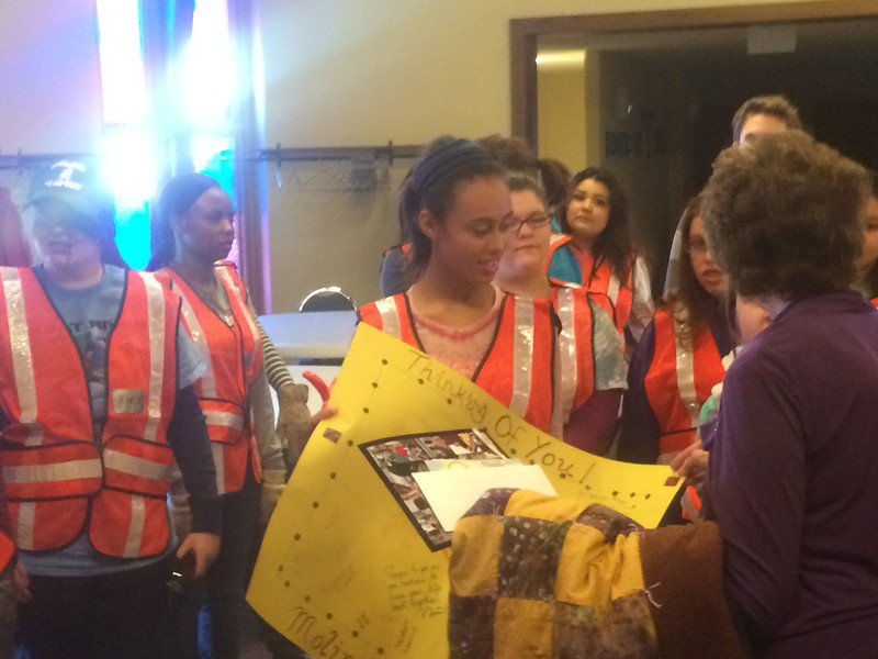 Students from Moline High School (Moline, Illinois) made a quilt for an employee of the Washington School District who lost her home.