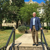 Parker Chesson in front of Koehler House on the campus of San Antonio College.